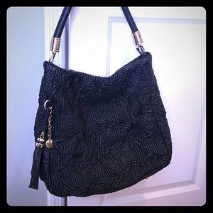 Large black rosette bag
